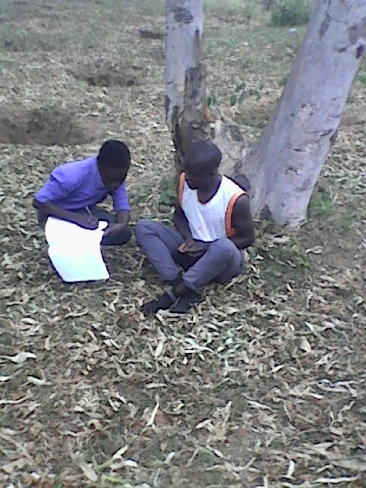 Katoto student interviews a boy who dropped out of school
